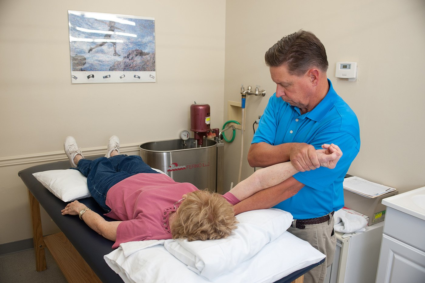 therapist holding patients arm
