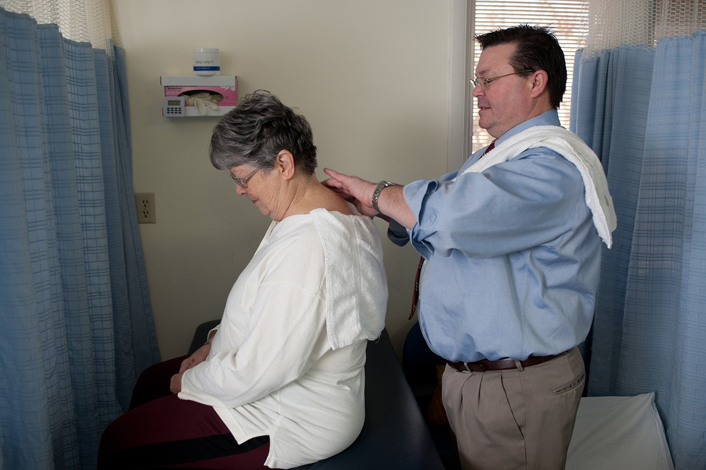 therapist massaging patients neck