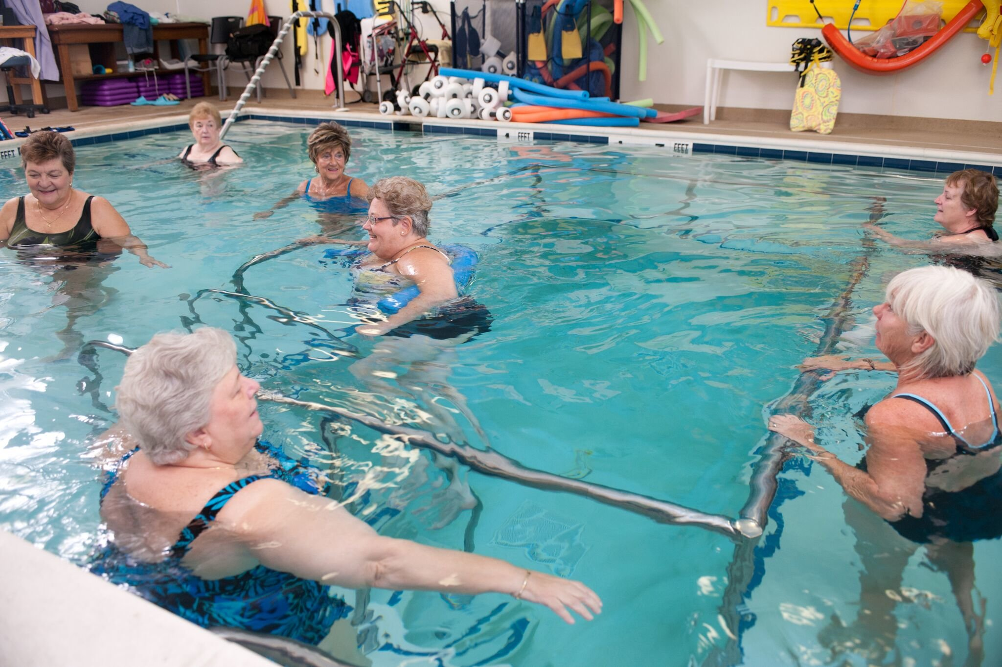several elderly patients in aquatic exercise pool