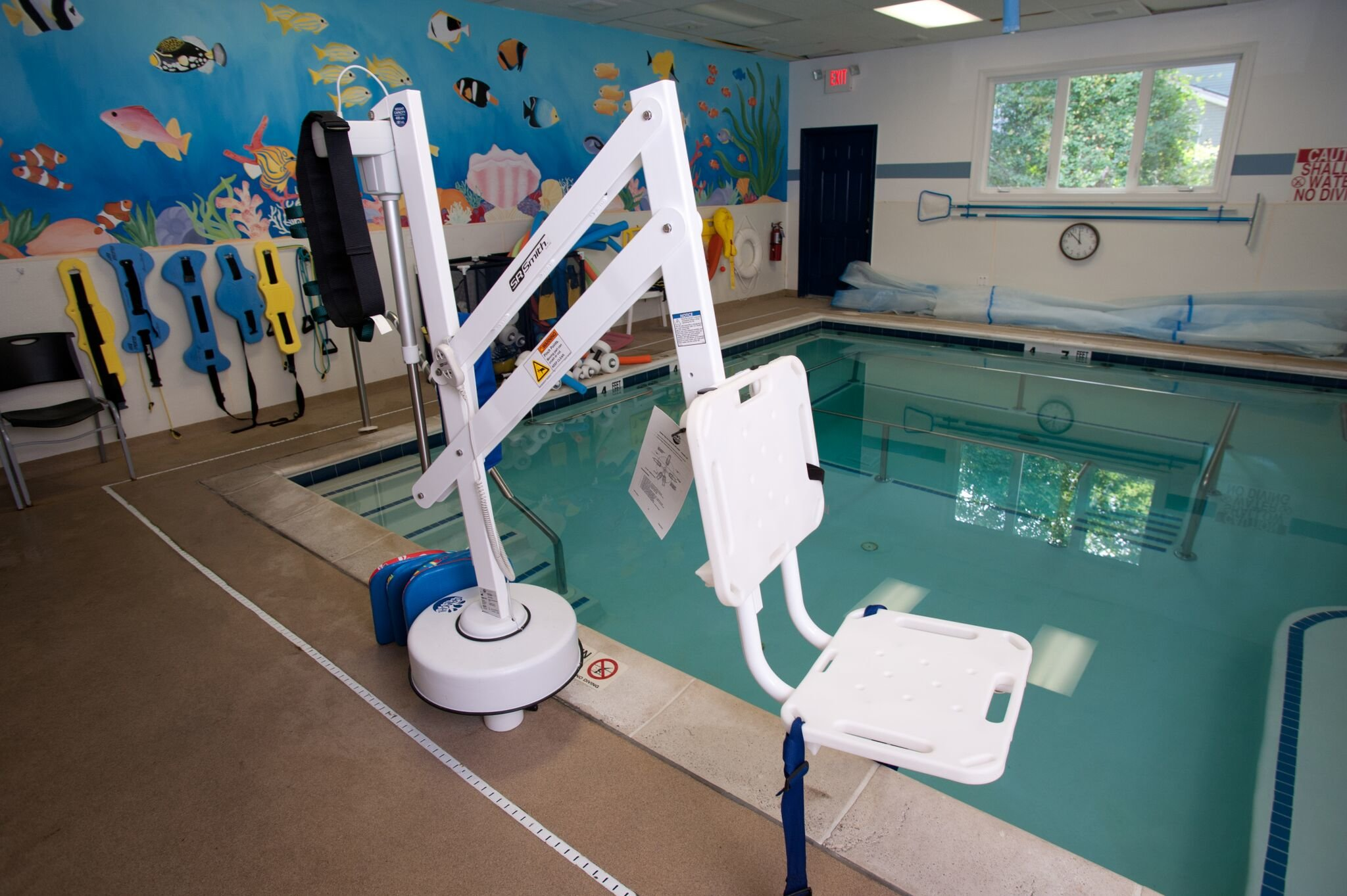 aquatic exercise pool and seat on extendable crane